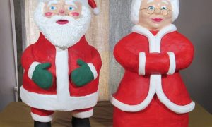 Mr and Mrs Santa Clause in paper mache