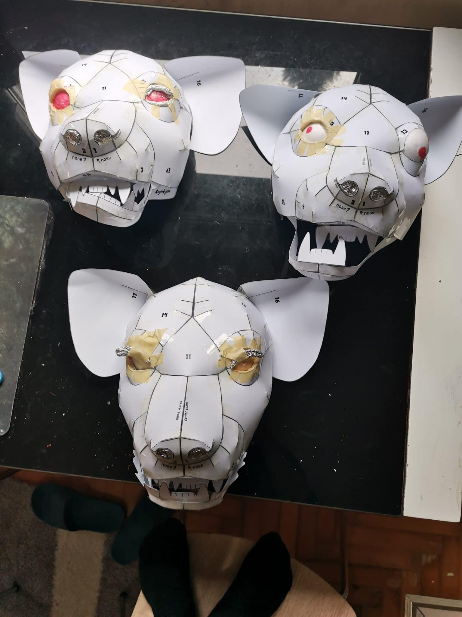 Paper mache hyena masks