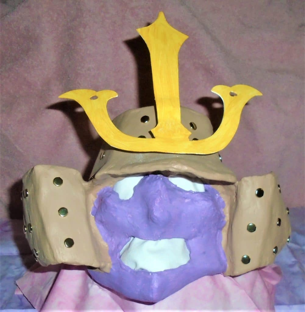 Helmet mask made with paper mache and papercraft pattern