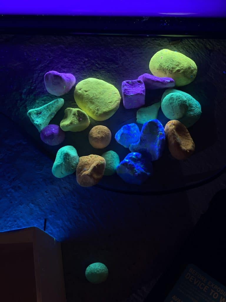Neon colored paper clay rocks.