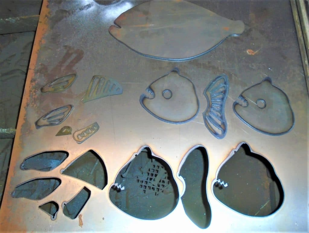 Pieces cut for steel fish sculpture