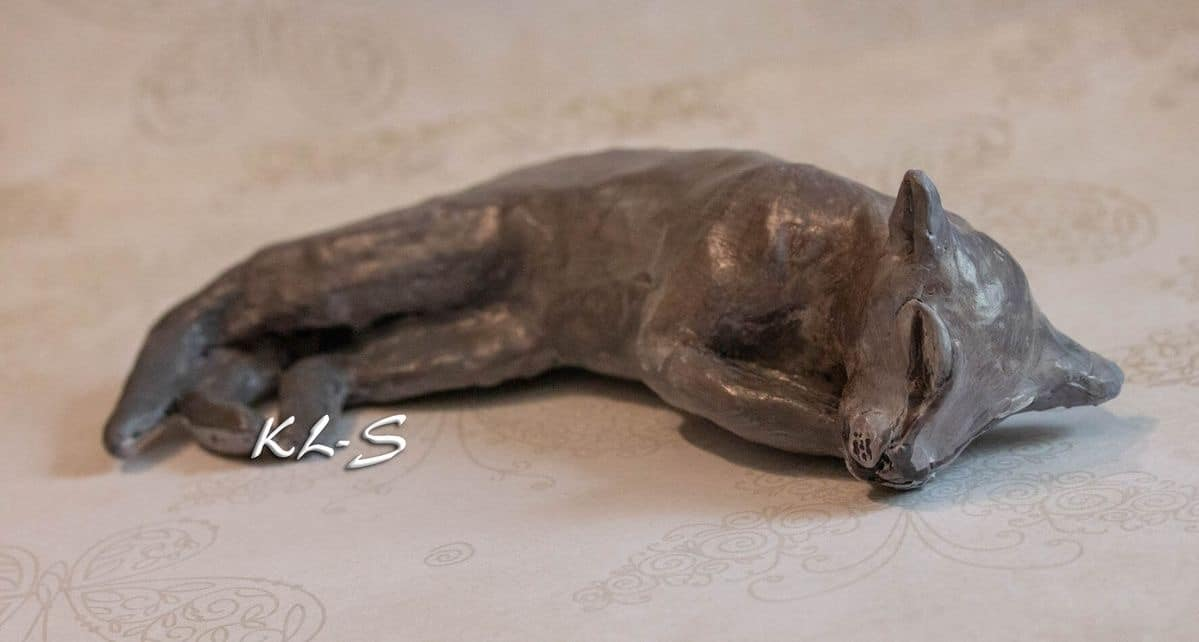 Sleeping cat sculpture