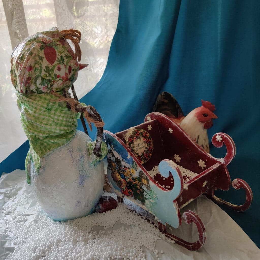 Paper mache snow lady with sleigh