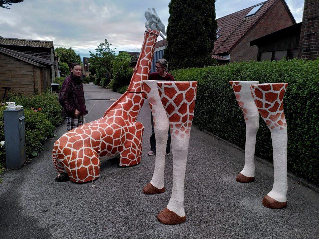 Large paper mache giraffe, taken apart