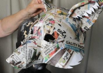 Add paper mache to the fox mask