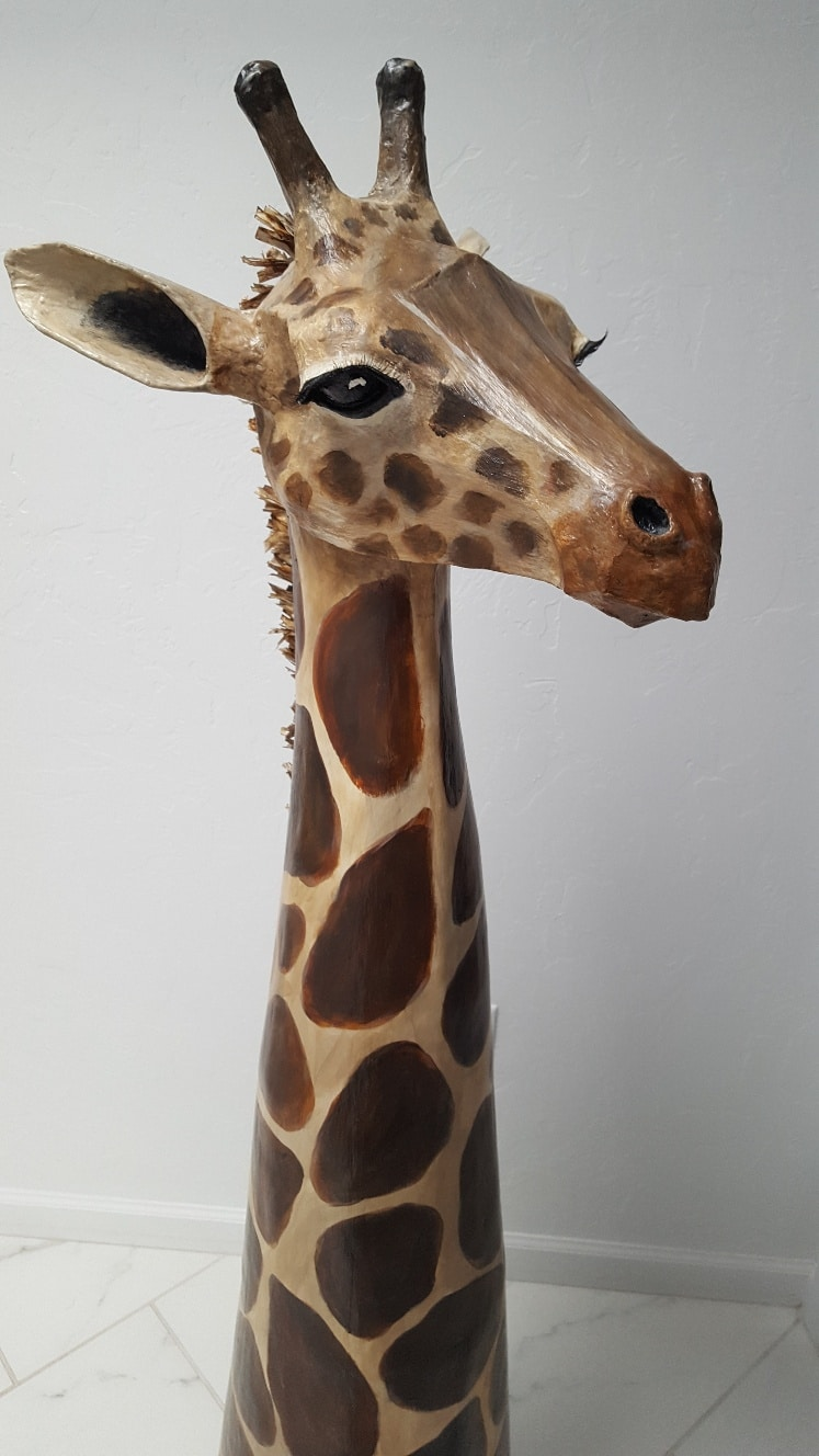 Paper mache giraffe head closeup
