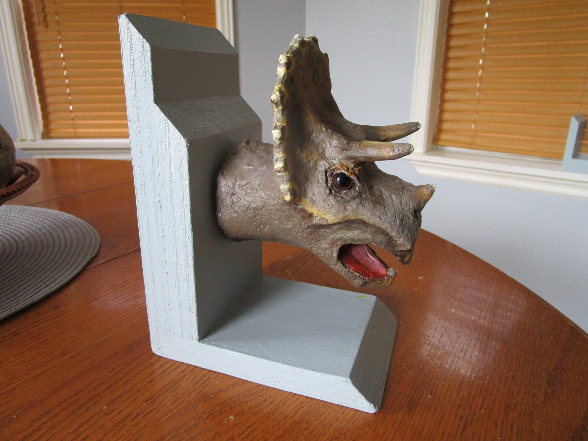 Dinosaur bookends made with paper mache