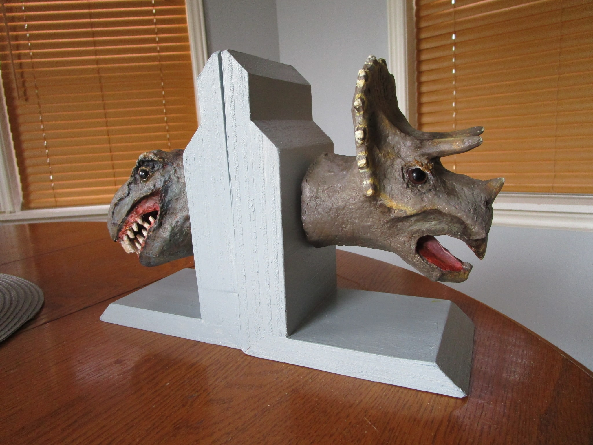 Dinosaur bookends made with paper mache clay