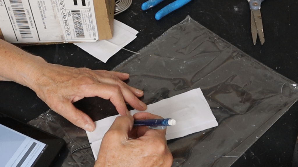 Draw the shape of your feather on the paper mache.