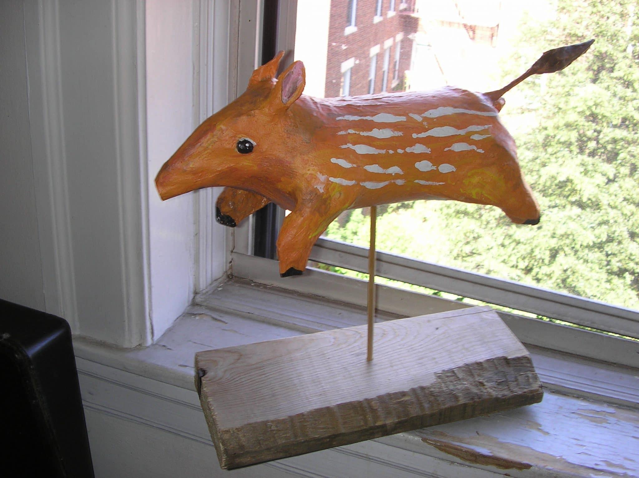 Flying paper mache tapir from a salt box