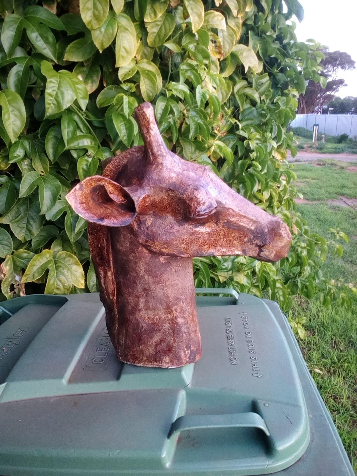 Stone-like paper mache giraffe