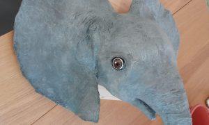 Paper mache baby elephant head sculpture