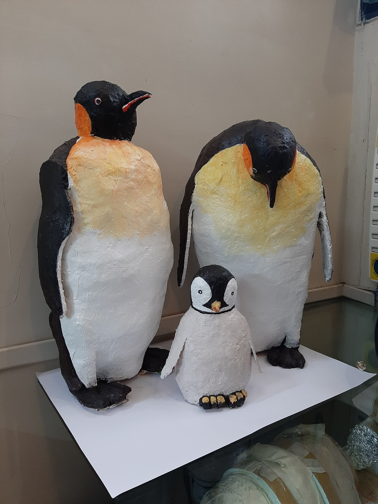 Paper mache penguin family