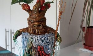 This aqua Mandrake is made with a mixture of Papier mache and air dry clay.