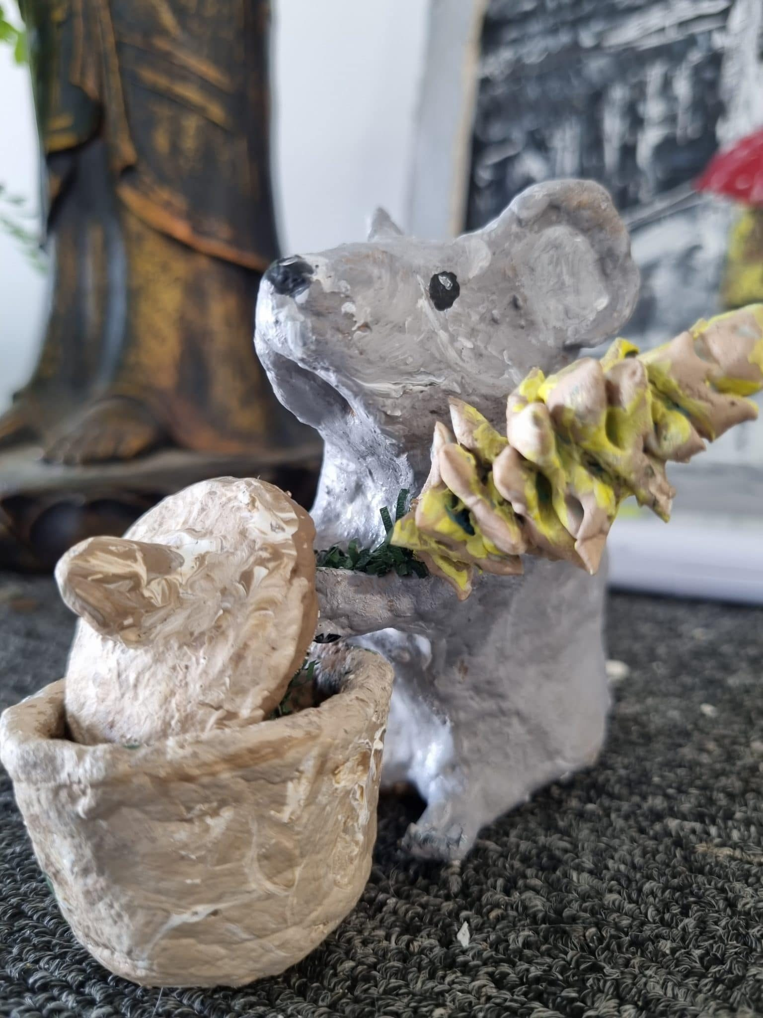 Paper mache mouse with wheat