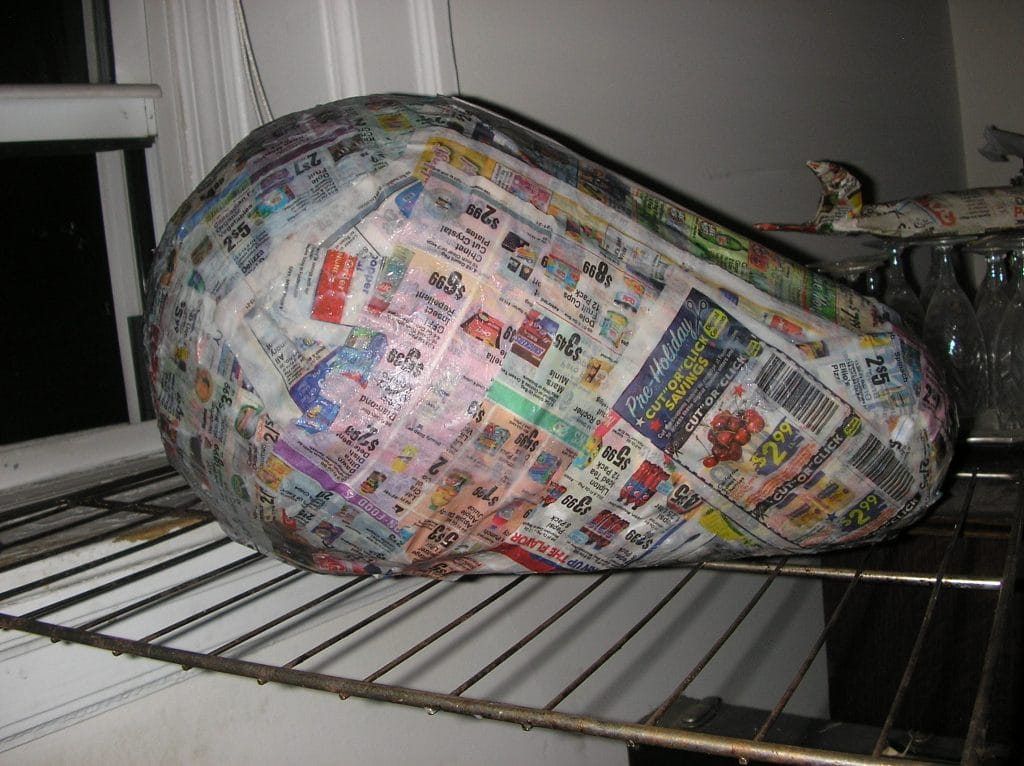 Cover armature with layer of paper mache