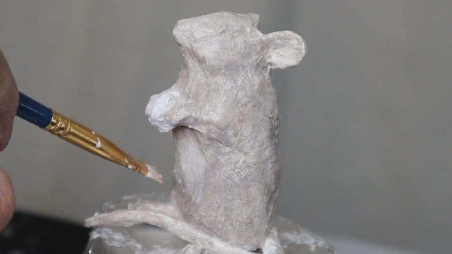 Painting the paper mache mouse grey