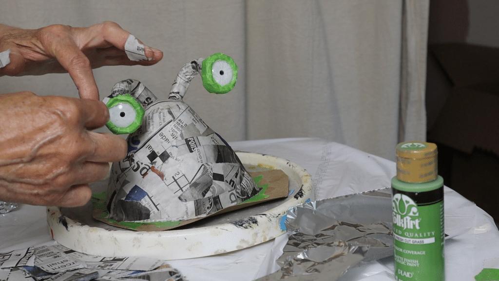 Adding masking tape to the eye sockets