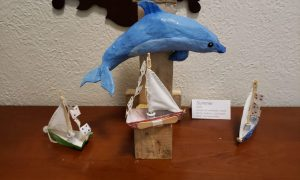 Paper mache dolphin and boats