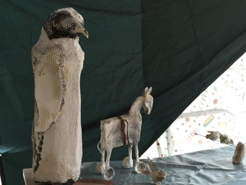 Penguin sculpture with horse