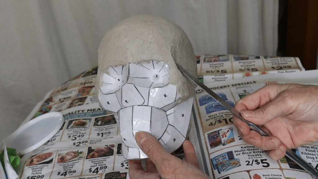 Covering the skull form with paper mache clay