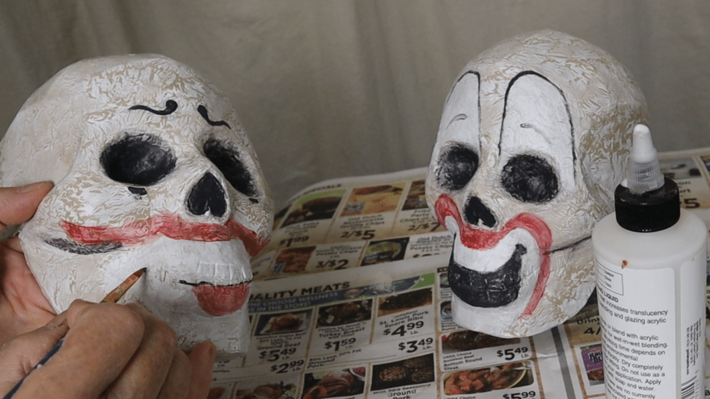 Painting clown faces on the skulls