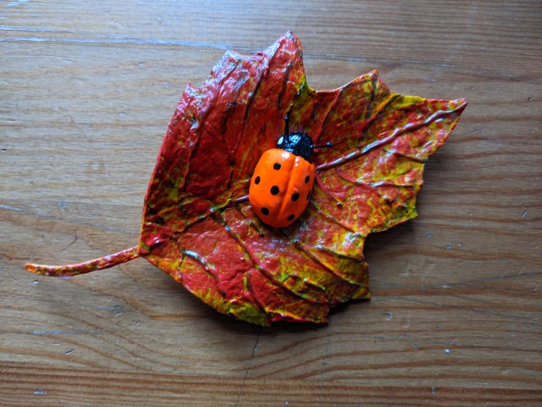 paper mache ladybug on a leaf