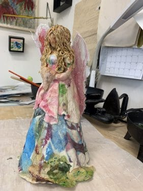 """Still Hush"" paper mache figure sculpture"
