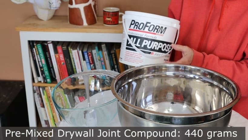 Weighing the drywall joint compound for paper mache clay.