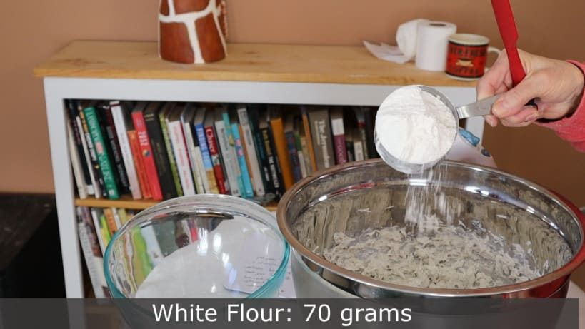 Weighing the white flour for paper mache clay.