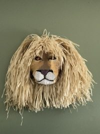 Lion head sculpture by Aline and Diane