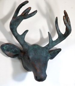 Paper mache deer head with bronze coating
